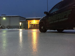In this image provided by the Hood River County Sheriff, lights from a school reflect off the ice-coated parking lot in Hood River, Ore., Wednesday, Jan. 18, 2017.