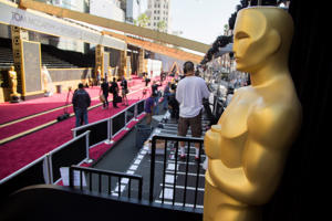 Feb 27, 2016; Hollywood, CA, USA; A giant Oscar statue looms over the red carpet during setup for the 88th annual Academy Awards at the Dolby Theater.