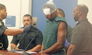 With a bandage over his eye, murder suspect Markeith Loyd attends his initial court appearance Thursday, Jan. 19, 2017 at the Orange County Jail in Orlando, Fla. Loyd was captured Tuesday evening, sustained injuries and transported to receive medical attention Orlando Regional Medical Center and moved to Corrections facility Wednesday evening. Orlando Police Master Lt. Debra Clayton, 42, was shot by suspect Markeith Loyd outside a Walmart store last week in west Orlando.