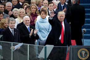 President Elect Donald Trump waves to spectators as Vice President Elect Mike Pence and Melania Trump look on at the West Front of the U.S. Capitol on January 20, 2017 in Washington, DC. In today's inauguration ceremony Donald J. Trump becomes the 45th president of the United States.