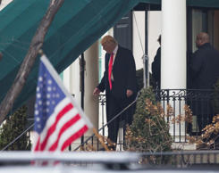 "U.S. President-elect Donald Trump waves from behind protective glass at the ""Mak..."