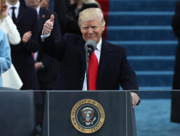 U.S. President Donald Trump gives a thumbs up after being sworn in as the 45th p...