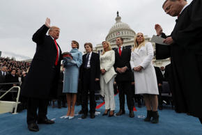 U.S. President Donald Trump takes the oath of office as his wife Melania holds t...