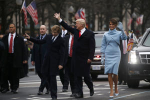 U.S. President Donald Trump and first lady Melania Trump walk along Pennsylvania Avenue during the inaugural parade from the U.S. Capitol in Washington, U.S., January 20, 2017.