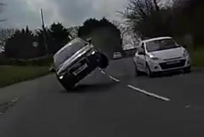 Motorist narrowly escapes hitting car on two wheels