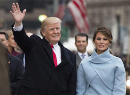 President Donald Trump and First Lady Melania Trump walk in their inaugural parade after being sworn-in as the 45th President.