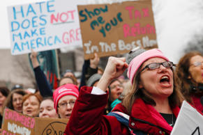 Protesters cheer at the Women's March on Washington during the first full day of...