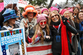 Gloria Steinem, center right, greets protesters at the barricades before speakin...
