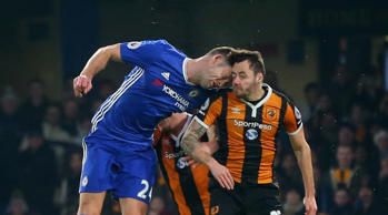 Gary Cahill of Chelsea bangs heads with Ryan Mason of Hull City during the Premi...
