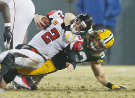 FILE - In this Dec. 8, 2014, file photo, Green Bay Packers' Clay Matthews sacks Atlanta Falcons' Matt Ryan during the second half of an NFL football game in Green Bay, Wis.