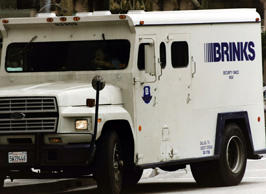 A Brinks security van collecting money.
