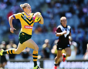 Chelsea Baker of the Australian Jillaroos makes a break on her way to score a try during the 2017 Auckland Nines match between the Kiwi Ferns and the Australian Jillaroos