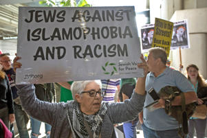 Demonstrators support a ruling by a federal judge in Seattle that grants a nationwide temporary restraining order against the presidential order to ban travel to the United States from seven Muslim-majority countries, at Tom Bradley International Terminal at Los Angeles International Airport on Feb. 4, 2017 in Los Angeles, Calif.