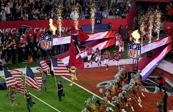 Slide 1 of 80: The Atlanta Falcons run on to the field before Super Bowl LI
