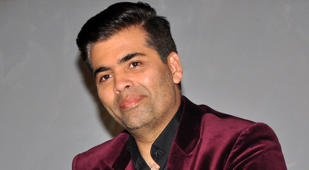 Karan Johar meets his twins