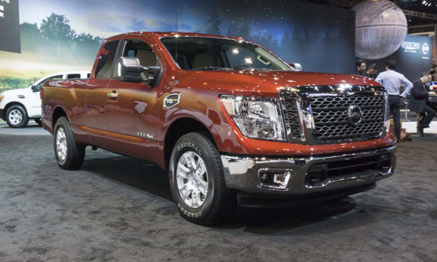 Slide 1 of 7: Nissan adds the new King Cab to the TITAN lineup, available for both the half-ton TITAN and the heavy-duty TITAN XD. Joining the Crew Cab and the Single Cab versions, the TITAN King Cab features a rear-hinged, wide-opening rear door for access to the second row, along with 6-passenger seating and a 6.5-foot bed.