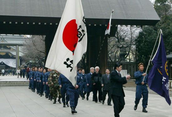 Slide 1 of 12: Worshippers holding Japanese flags visit the Yasukuni Shrine to celebrate National Foundation Day on February 11, 2003 in Tokyo Japan. According to the earliest Japanese history books on this day in the year 660 BC the first Japanese emperor was crowned.  (Koichi Kamoshida/Getty Images)