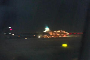 One witness photographed what appeared to be embers coming from the fuselage (Photo: twitter/Alice X. Zhang)