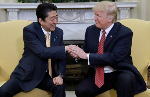 President Donald Trump shakes hands with Japanese Prime Minister Shinzo Abe in the Oval Office of the White House in Washington, Friday, Feb. 10, 2017. (AP Photo/Evan Vucci)