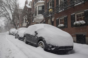 Snow covered cars in the Beacon Hill neighborhood as a winter storm bears down on Feb. 9, 2017 in Boston.