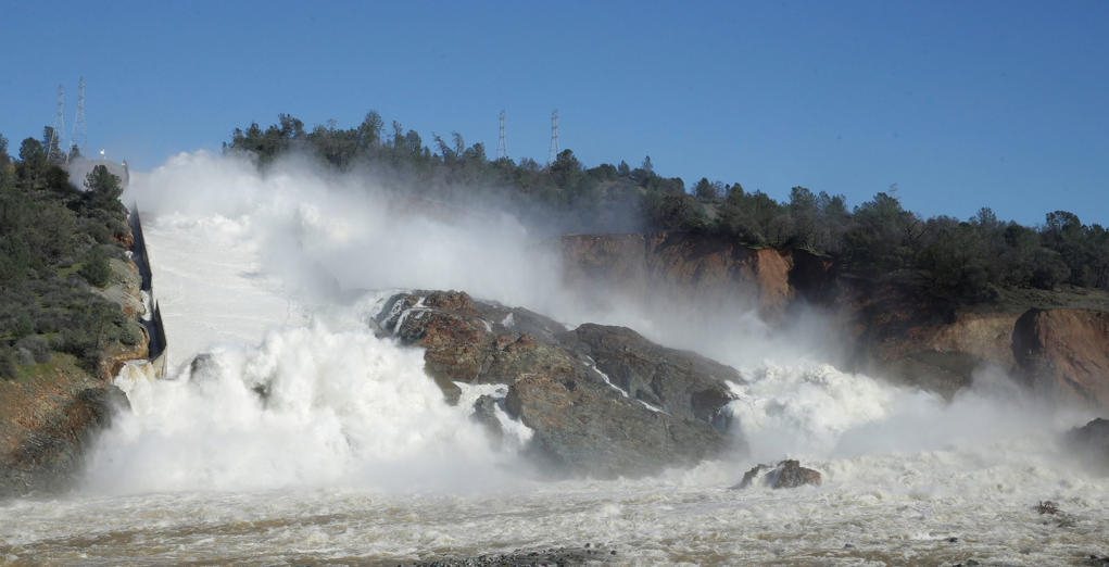 "In this Saturday, Feb. 11, 2017, water flows down Oroville Dam's main spillway, near Oroville, Calif. Officials have ordered residents near the Oroville Dam in Northern California to evacuate the area Sunday, Feb. 12, saying a ""hazardous situation is developing"" after an emergency spillway severely eroded."