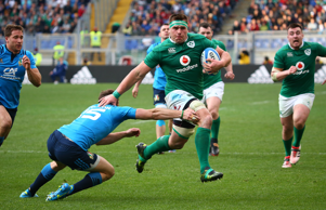 Ireland's CJ Stander in action with Italy's Edoardo Padovani