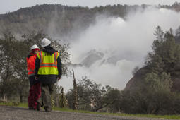 A team from the Department of Water Resource, monitors the section of damaged main spillway at Oroville dam in Oroville, California, USA, 13 February 2017. Authorities ordered mandatory evacuations of communities below the Oroville Dam, where a hole was found in its emergency spillway, threatening a possible breach and flooding of low lying areas below the dam. Some 170,000 people were ordered to leave their home for high or safer ground.