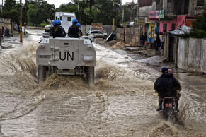 Brazilian peacekeepers with the UN Force Commander conduct a patrol in downtown Port au Prince in October 2016, in the wake of Hurricane Matthew. In 2017, after a 13-year stay, the United Nation's multinational military force is on its way out.
