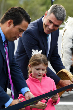 Simon Bridges, Grace Ahern and Nathan Guy cut the ribbon at the opening of the Peka Peka to Mackays Crossing expressway.
