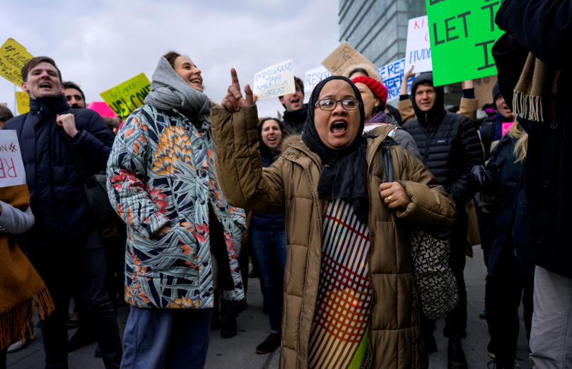 Slide 9 of 14: Protesters assemble at John F. Kennedy International Airport in New York, Saturday, Jan. 28, 2017 after two Iraqi refugees were detained while trying to enter the country. On Friday, Jan. 27, President Donald Trump signed an executive order suspending all immigration from countries with terrorism concerns for 90 days. Countries included in the ban are Iraq, Syria, Iran, Sudan, Libya, Somalia and Yemen, which are all Muslim-majority nations. (AP Photo/Craig Ruttle)