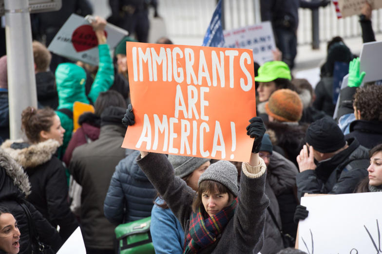 Slide 4 of 14: Protesters gather at JFK International Airport's Terminal 4 to demonstrate against President Donald Trump's executive order on January 28, 2017, in New York. Trump has signed a sweeping executive order to suspend refugee arrivals and impose tough controls on travellers from Iran, Iraq, Libya, Somalia, Sudan, Syria and Yemen. / AFP / Bryan R. Smith (Photo credit should read BRYAN R. SMITH/AFP/Getty Images)