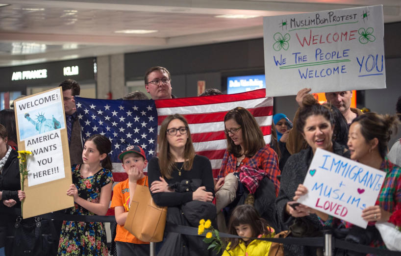 "Slide 13 of 14: Protesters gather at the international arrivals area of Dulles International Airport on January 28, 2017, in Sterling, Virginia. US President Donald Trump boasted Saturday that his ""very strict"" crackdown on Muslim immigration was working ""very nicely,"" amid mounting resistance to the order which has been branded by many as blatantly discriminatory. / AFP / PAUL J. RICHARDS (Photo credit should read PAUL J. RICHARDS/AFP/Getty Images)"