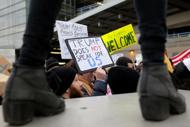Slide 1 of 14: People gather during an anti-Donald Trump immigration ban protest outside Terminal 4 at John F. Kennedy International Airport in Queens, New York, U.S. January 28, 2017. REUTERS/Andrew Kelly