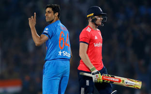 India v England - Second T20 International - Vidarbha Cricket Association Stadium, Nagpur, India - 29/01/17. India's Ashish Nehra (L) celebrates the wicket of England's Sam Billings (R)