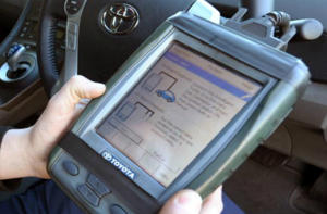 Mechanic plugs device into OBD-II port, the same port utilized by insurance telematics devices