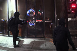 A rioter smashes a window at a Mechanics Bank branch during a protest against Breitbart News editor Milo Yiannopoulos in Berkeley, California, USA, 01 February 2017. Hundreds of protesters rallied against Yiannopoulos, forcing the cancellation of his speech at UC Berkeley, eventually vandalizing dozens of businesses and smashing dozens of storefront windows. University police locked down all buildings after the protests turned violent.