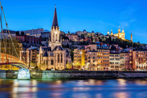 Nighttime cityscape of Lyon, France from the Saone River.