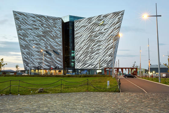 Slide 1 of 9: Facade of the 'Titanic Belfast' visitor attraction and monument to Belfast's maritime heritage.