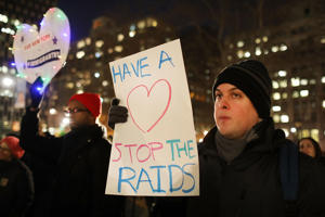 People attend a Valentines Day rally organized by the New York Immigration Coalition called 'Love Fights Back' on February 14, 2017 in New York City.