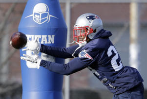 New England Patriots cornerback Cyrus Jones (24) catches a pass during an NFL football team practice Wednesday, Dec. 21, 2016, in Foxborough, Mass.