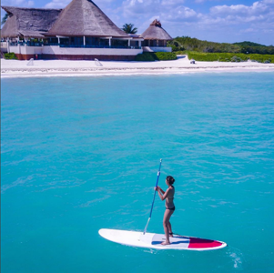 Paddleboarding in crystal clear waters during a recent trip to Mexico (Photo: Instagram/echosierra85)