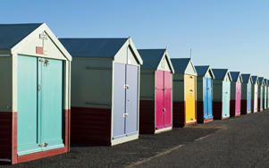 Colourful beach huts line the seafront at Hove CREDIT: AP/FOTOLIA