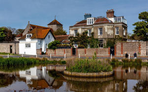 Period houses overlook the village pond in Rottingdean CREDIT: ALAMY