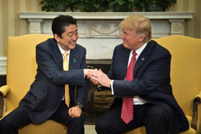 Japan's Prime Minister Shinzo Abe and US President Donald Trump shake hands before a meeting in the Oval Office of the White House on February 10, 2017 in Washington, DC.
