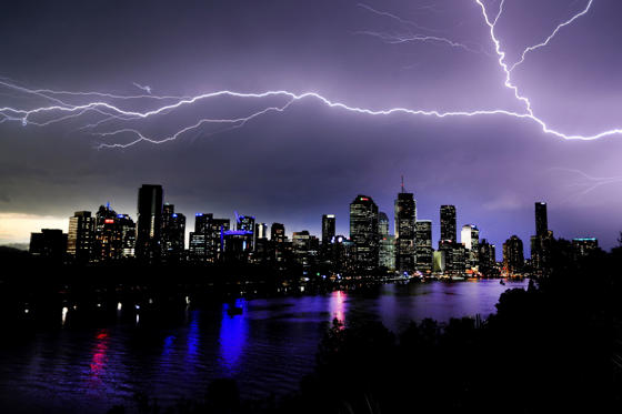 Slide 1 of 21: Lightning over Brisbane, Australia - 13 Feb 2017 Lightning strikes over Brisbane CBD from Kangaroo Point in Brisbane, Queensland