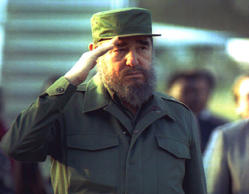 Cuban President Fidel Castro salutes during a welcoming ceremony for Zambian President Frederick Chiluba at Havana's Jose Marti airport, 25 April 1994.