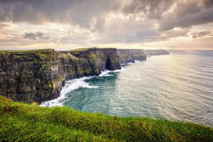 Cliffs of Moher, County Clare, Ireland, The Burren, Europe are one of Ireland's top touristic attractions. The maximum height of Cliffs is 214 m, length 8 km.