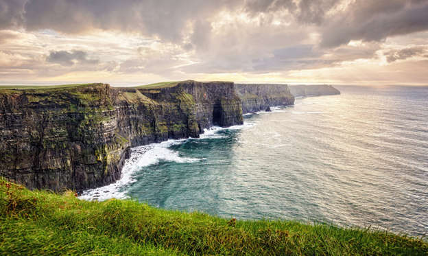 Slide 1 of 23: Cliffs of Moher, County Clare, Ireland, The Burren, Europe are one of Ireland's top touristic attractions. The maximum height of Cliffs is 214 m, length 8 km.
