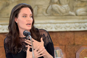 Hollywood star Angelina Jolie speaks to media during a press conference at a hotel in Siem Reap on February 18, 2017. Angelina Jolie will unveil her new film on the horrors of the Khmer Rouge era on February 18 at the ancient Angkor Wat temple complex in Cambodia, a country the star shares a deep affinity with through her adopted son Maddox.