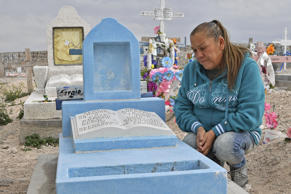 Maria Guadalupe Guereca, 60, visits the grave of her son Sergio Hernandez at the Jardines del Recuerdo cemetery in Ciudad Juarez, Chihuahua, Mexico, during an interview with AFP on February 18, 2017. The shooting occurred June 7, 2010 while Sergio Hernandez was spending time with three friends on the banks of the Rio Grande, which separates Ciudad Juarez in Mexico from El Paso in Texas, US. Sergio was shot dead at 15 by police officer Jesus Mesa.